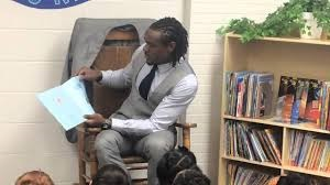 Brandon Carr reads to students at Dye Elementary School.